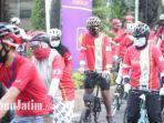 kegiatan-gowes-merah-putih-oleh-komunitas-sepeda-brompton-surabaya.jpg