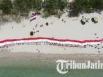 merah-putih-di-pantai-dalegan_20180819_154734.jpg