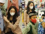 miss-supermodel-worldwide-indonesia-nova-restalita-memakaikan-baju-baru-untuk-anak-yatim-piatu.jpg