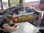 petugas-gabungan-di-kota-kediri-melakukan-pendataan-pelanggar-protokol-kesehatan-covid-19.jpg