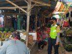 petugas-kepolisian-melakukan-patroli-di-pasar-tradisional-di-bagor-nganjuk.jpg