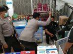 petugas-melakukan-olah-tkp-di-lokasi-pembobolan-sebuah-minimarket-di-mojokerto.jpg