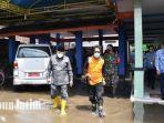 pj-bupati-sidoarjo-hudiyono-mengunjungi-lokasi-banjir-tanggulangin.jpg