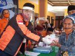 pt-pos-indonesia-salurkan-bantuan-di-giliyang-sumenep.jpg