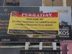 reklame-ditutupi-banner-oleh-bapenda-kota-malang-karena-menunggak-pajak.jpg