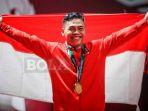 selebrasi-lifter-indonesia-eko-yuli-irawan-saat-berhasil-meraih-medali-emas_20180823_081403.jpg
