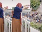 sosok-perempuan-yang-viral-dibicarakan-karena-bagi-bagi-uang-ratusan-juta-dari-balkon.jpg