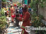 suasana-simulasi-kebakaran-oleh-pmk-surabaya-di-rw-6-kelurahan-jepara-kecamatan-bubutan.jpg