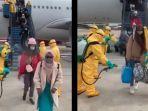 viral-video-wni-dari-china-disemprot-disinfektan.jpg