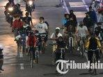 warga-bersepeda-di-jalan-protokol-kota-surabaya-ilustrasi-bersepeda.jpg