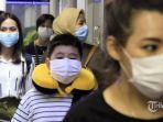 wisatawan-asal-malaysia-di-pelabuhan-batam-pakai-masker-cegah-virus-corona.jpg