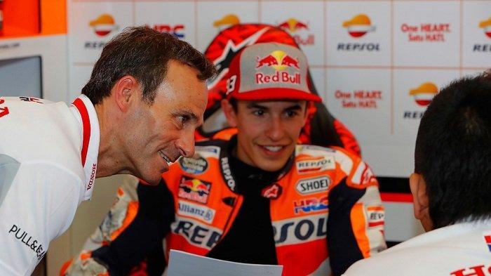 Alberto Puig (kiri) dan Marc Marquez.