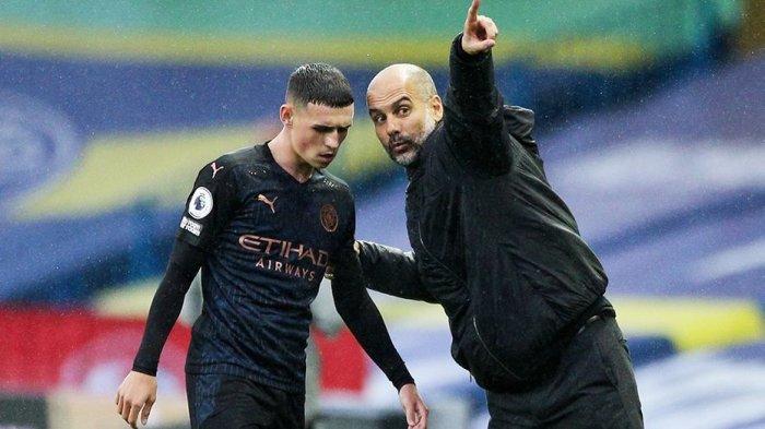 Pep Guardiola dan Phil Foden