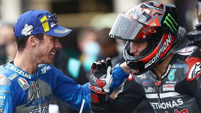 Interaksi Joan Mir (Suzuki Ecstar/kiri) dengan Fabio Quartararo (Petronas Yamaha SRT) setelah balapan MotoGP Catalunya di Sirkuit Catalunya, Spanyol, 27 September 2020.
