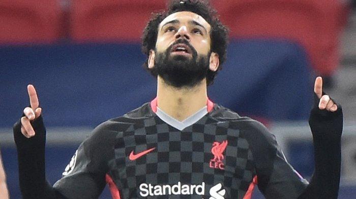 Mohamed Salah merayakan gol di leg pertama babak 16 besar Liga Champions RB Leipzig vs FC Liverpool di Puskas Arena di Budapest pada 16 Februari 2021.