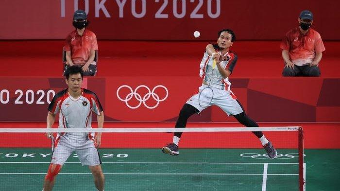 Pasangan ganda putra Indonesia, Mohammad Ahsan/Hendra Setiawan, pada laga penyisihan terakhir grup Olimpiade Tokyo 2020, Selasa (27/7/2021).