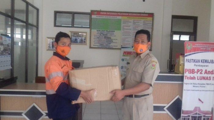 PPKM Diperpanjang, BPBD Magelang Bagikan 14 Ribu Masker