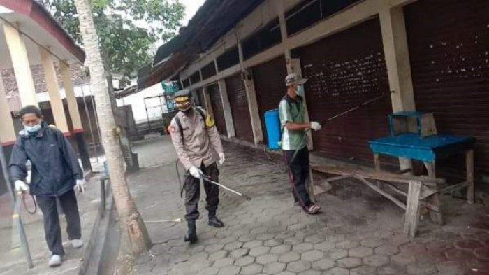 Putus Rantai Penyebaran Covid-19, Polresta Magelang Semprotkan Disinfektan di Pasar Burung Magelang