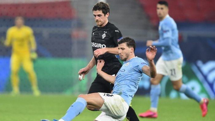 Ruben Dias dan Jonas Hofmann di leg pertama babak 16 besar Liga Champions, Borussia Moenchengladbach vs Manchester City di Puskas Arena di Budapest pada 24 Februari 2021.