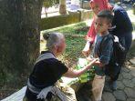 anak-anak-berkebutuhan-khusus-dari-griya-special-children-magelang-membagikan-nasi-kotak_20180330_145713.jpg