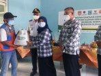anak-yatim-juru-parkir-legiun-veteran-hingga-pkl-terdampak-covid-di-sleman-diberi-bantuan.jpg