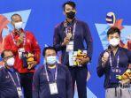 atlet-renang-jawa-barat-triady-fauzi-sidiq-menjadi-yang-tercepat-dan-meraih-medali-emas-pon.jpg