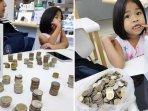 aviral-gadis-kecil-beli-handphone-pakai-setumpuk-uang-koin-ternyata-dari-hasil-menabung-sendiri.jpg