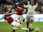 declan-rice-of-west-ham-in-action-with-paul-pogba_20180511_041218.jpg