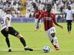 franck-kessie-vs-mehdi-bourabia-di-liga-serie-a-antara-spezia-vs-ac-milan-di-stadion-alberto-picco.jpg