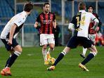 hakan-calhanoglu-saat-serie-a-italia-sampdoria-vs-ac-milan-di-stadion-luigi-ferrari-di-genoa.jpg