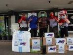 jne-distribusikan-100-ton-bantuan-covid-19-ke-seluruh-indonesia-selama-tahun-2020.jpg