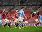john-stones-mencetak-gol-di-semifinal-piala-liga-inggris-antara-manchester-united-vs-manchester-city.jpg