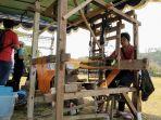 jumilah-penenun-stagen-1016-meter-asal-sleman-yang-berhasil-pecahkan-rekor-dunia_20181007_142433.jpg