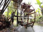 kincir-air-memanfaatkan-tenaga-dari-alam-untuk-mengangkat-air-di-aliran-sungai.jpg