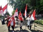 komunitas-pedagang-malioboro-tebar-optimisme-dengan-berbagi-dan-pasang-bendera-merah-putih.jpg
