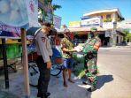 patroli-gabungan-tni-polri-desa-karangdowo-melaksanakan-kegiatan-jumat-berkah.jpg