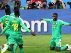 pemain-timnas-senegal-mbaye-niang-merayakan-golnya-ke-gawang-timnas-polandia_20180629_081812.jpg