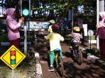 peringati-hut-ke-38-yayasan-kemala-bhayangkari-ajak-ratusan-anak-tk-mengenal-safety-riding_20180309_103807.jpg
