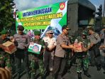 polres-dan-kodim-0705magelang-salurkan-bantuan-kemanusiaan-untuk-korban-gempa-di-lombok_20180810_194429.jpg