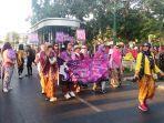 sejumlah-komunitas-batik-melakukan-long-march-di-sepanjang-jalan-malioboro.jpg