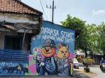 viral-mural-dipaksa-sehat-di-negara-yang-sakit-di-pasuruhan-pak-camat-dapat-perintah-menghapusnya.jpg