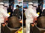 viral-video-dua-pengunjung-supermarket-belanja-pakai-baju-hazmat.jpg
