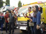 wakil-wali-kota-yogyakarta-heroe-poerwadi-bersama-panitia-dan-wanita-driver-truk_20180907_171215.jpg