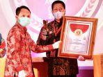 wali-kota-magelang-sigit-widyonindito-menerima-innovative-government-award.jpg
