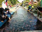 wisata-ikan-di-bendung-lepen-sungai-gajah-wong-yogya.jpg