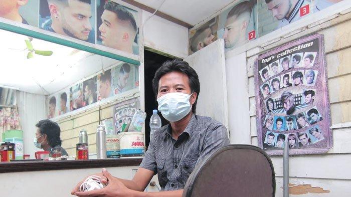 Ahmad Muhyiddin (35), tukang cukur yang berkesempatan memangkas rambut Ustaz Abdul Somad