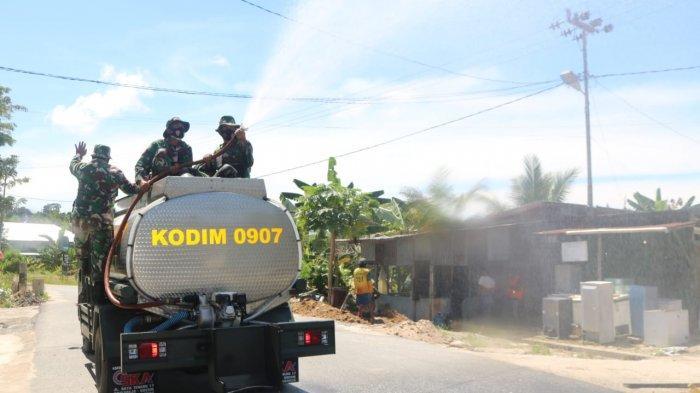 Pencegahan Covid-19 di Karang Harapan Tarakan, Satgas TMMD Lakukan Penyemprotan Disinfektan