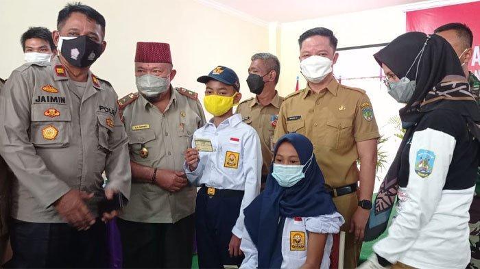 Vaksinasi Covid-19 siswa SMP Negeri Terpadu Unggulan 2 Tana Tidung, di Kecamatan Sesayap Hilir, Senin (20/9/2021) lalu. (TRIBUNKALTARA.COM / RISNA)