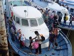 deportasi-pmi-dari-malaysia-tiba-di-pelabuhan-tunon-taka-nunukan-31072021.jpg