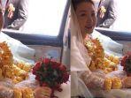 pengantin-perempuan-di-hubei-china-mengenakan-kalung-emas-seberat-60-kilogram.jpg
